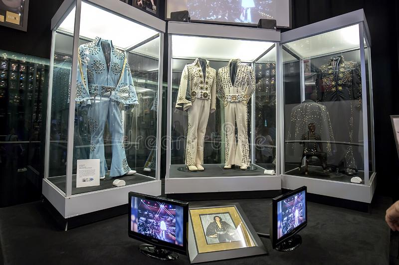 A Variety Of Elvis Presley Stage Uniforms At Graceland royalty free stock photo