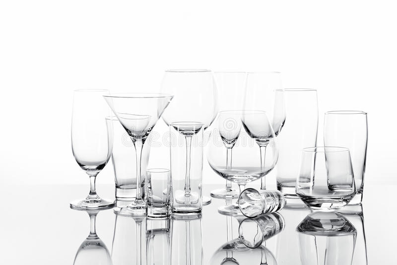 Drinking Glasses. Variety of empty drinking glasses royalty free stock photography