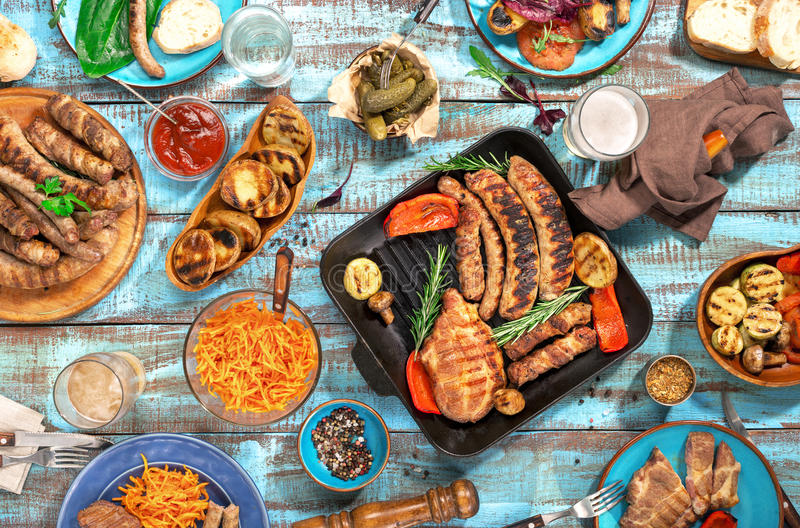 Variety of food grilled on wooden table, top view royalty free stock photography