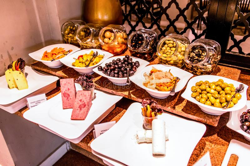 Variety food buffet table, wine snack set, olives, cheese and other appetizer, italian antipasti on plate in Egypt. Variety food on table, wine snack set, olives stock images