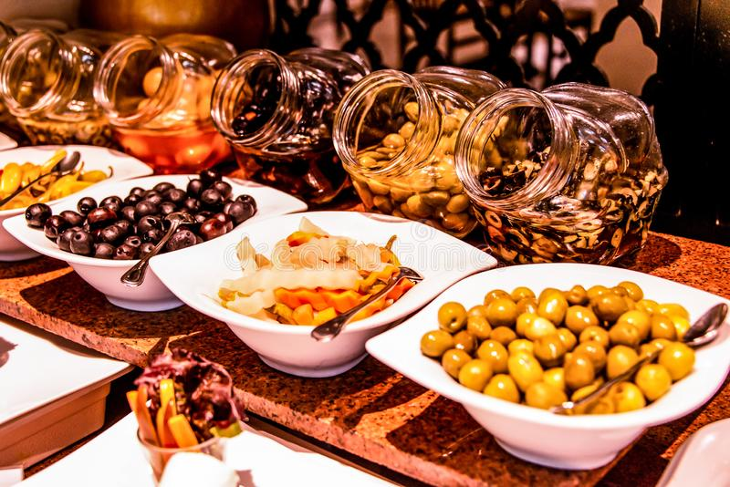 Variety food buffet table, wine snack set, olives, cheese and other appetizer, italian antipasti on plate in Egypt. Variety food on table, wine snack set, olives royalty free stock photos