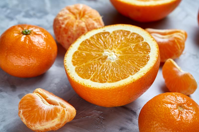 Variety of fresh citrus fruits for making juice or smoothie over light textured background, top view, selective focus. stock photography