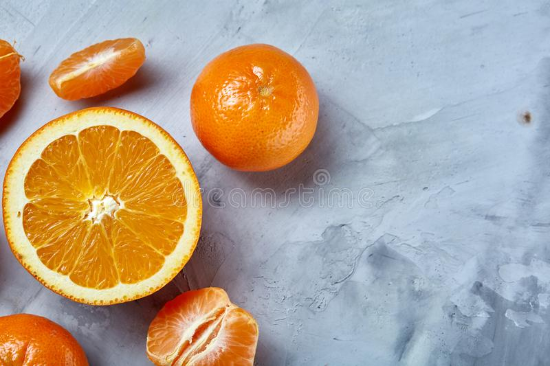Variety of fresh citrus fruits for making juice or smoothie over light textured background, top view, selective focus. royalty free stock photos