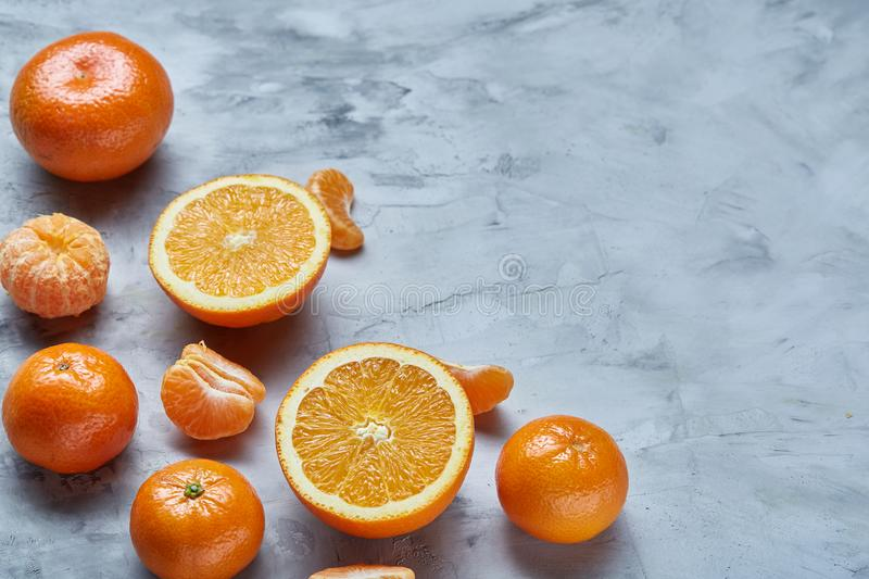 Variety of fresh citrus fruits for making juice or smoothie over light textured background, top view, selective focus. stock photo