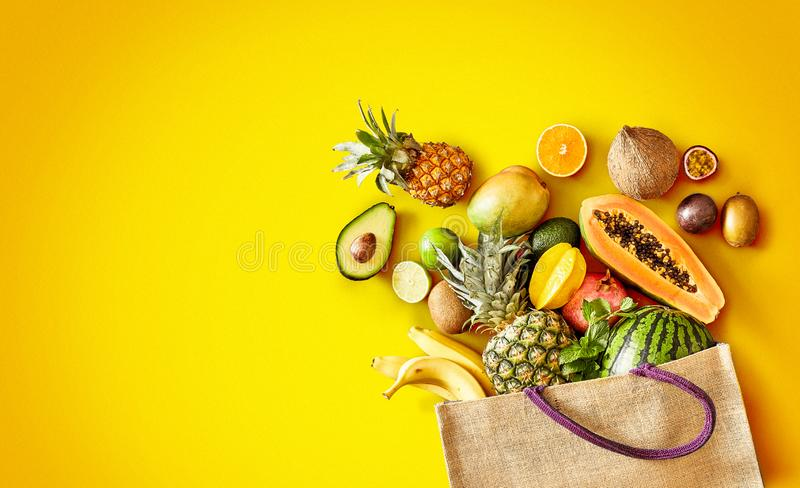 Variety of fresh tropical fruit on exotic yellow royalty free stock photo
