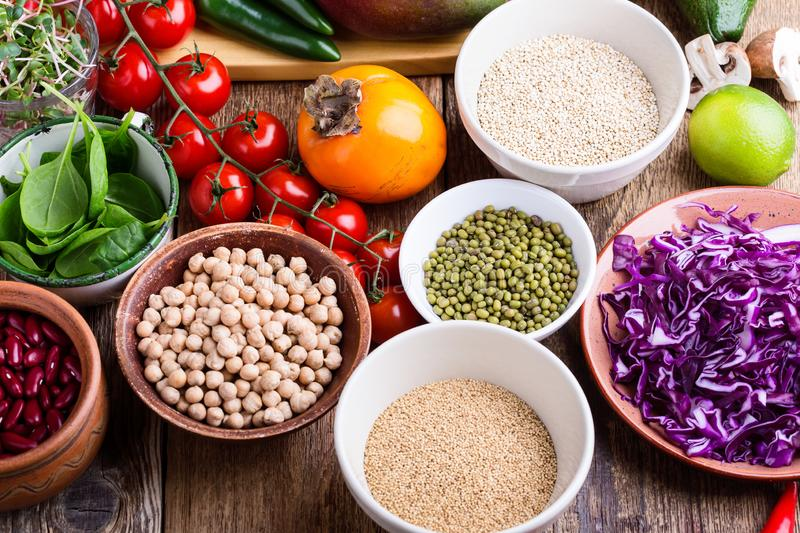 Variety of fresh vegetables, fruits, dry grains and beans stock images
