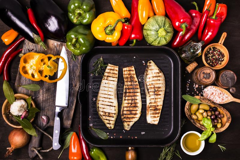 Variety of fresh vegetables and grilled aubergines royalty free stock images