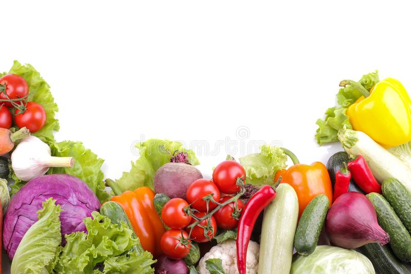 A variety of vegetables including tomato pepper cabbage beetroot zucchini and carrot leaves garlic and cucumber salad on whi stock photos