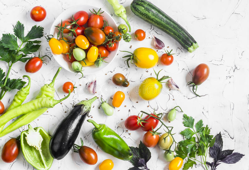 Variety of fresh vegetables - tomatoes, peppers, eggplant, zucchini on a white background stock photo