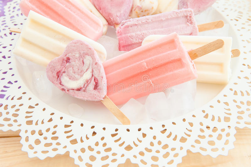 Variety of frozen popsicles royalty free stock images