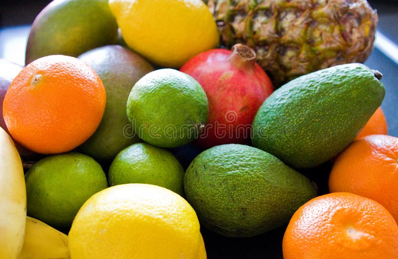 Variety of fruit on kitchen table. Colorful variety of fruit laid on kicthen countertop or table. Oranges, pineapple, limons, lemons and many others. Fruits stock images