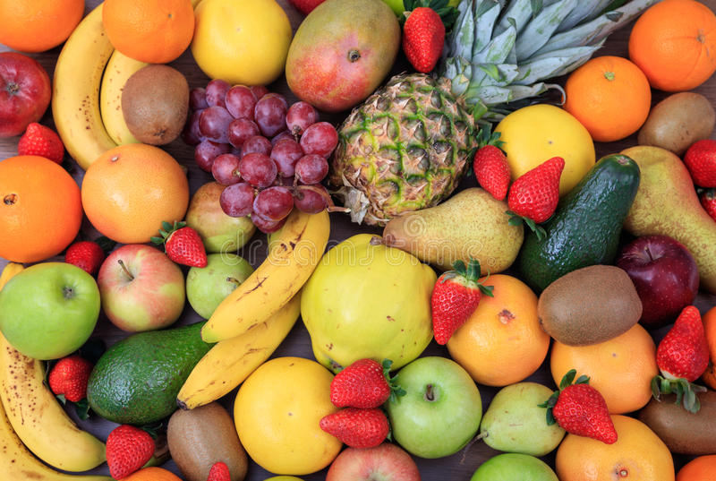 Variety of fruits background. A variety of colorful fresh fruits background stock photography