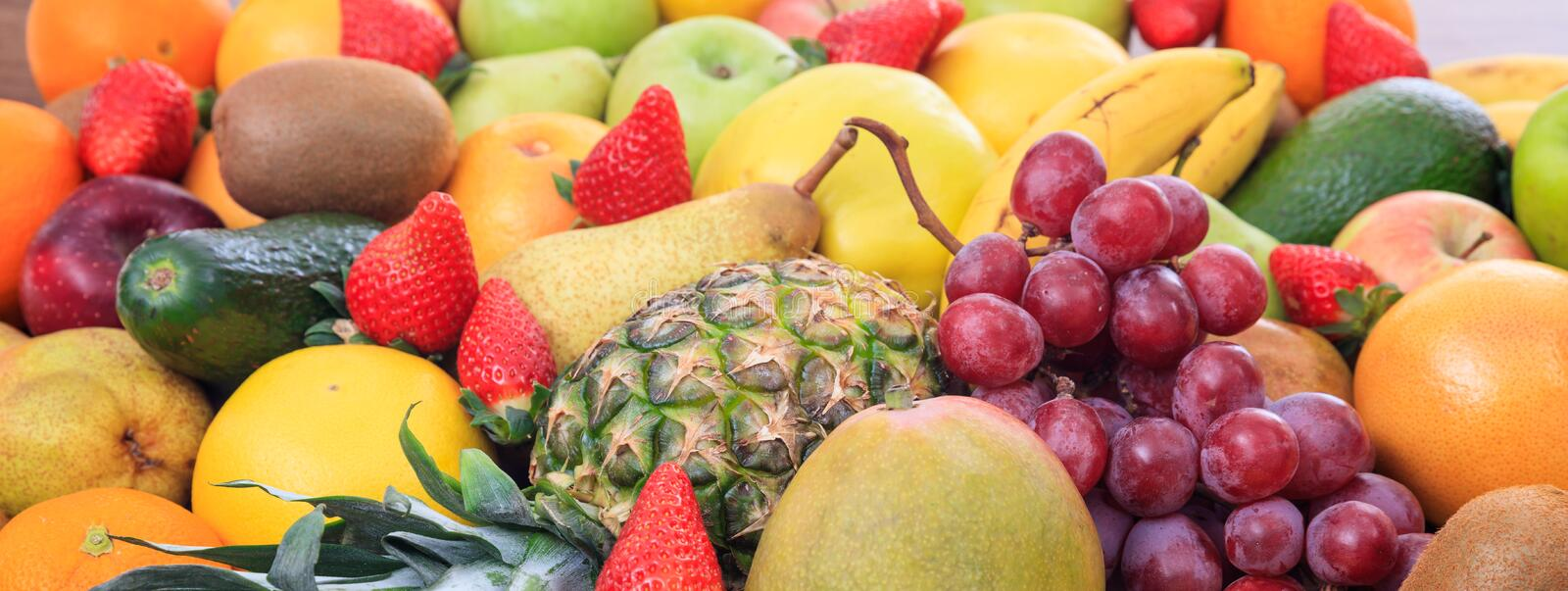 Variety of fruits background. A variety of colorful fresh fruits background royalty free stock photos