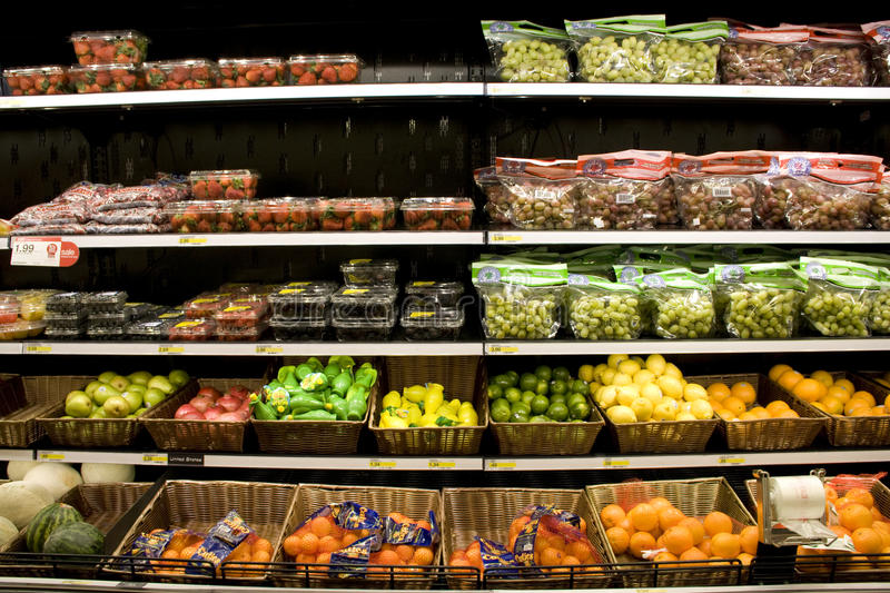 Variety of fruits on store shelves. For sale royalty free stock photo