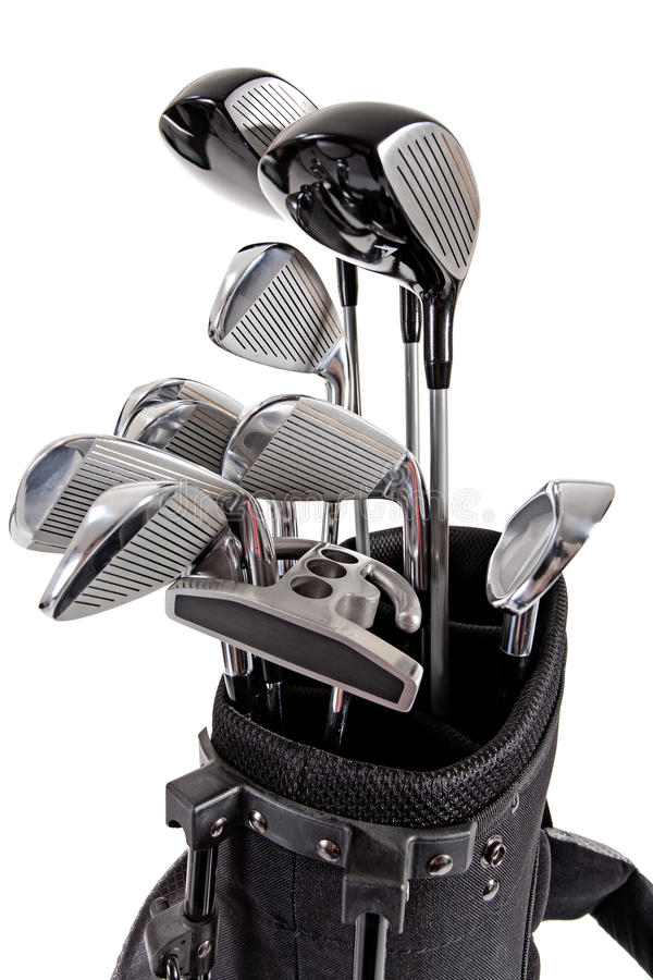 Variety of golf clubs stock photo