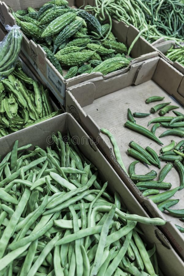 Variety of green beans in boxes shot from up close - healthy eating stock photo