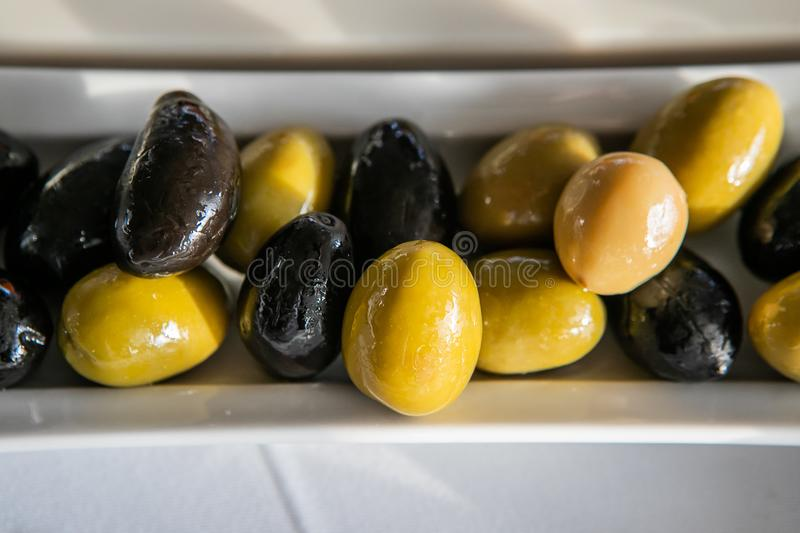 Variety Of Green And Black Marinated Olives stock images