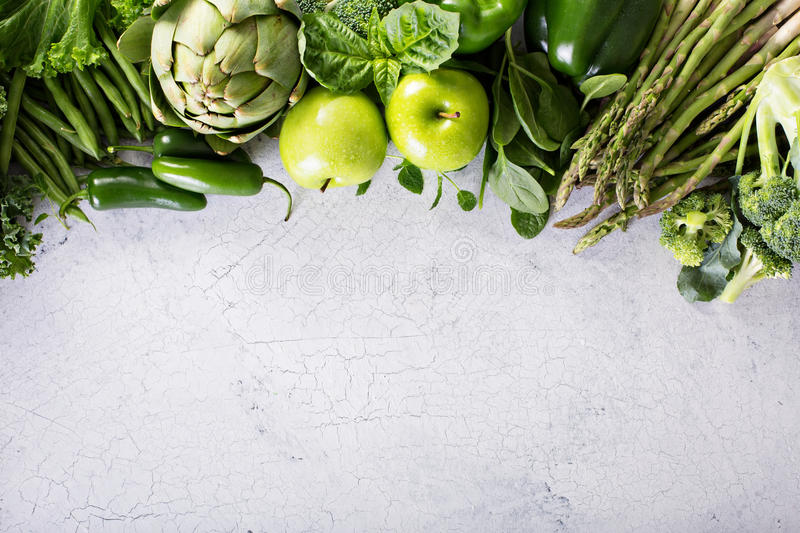 Variety of green vegetables and fruits stock photos