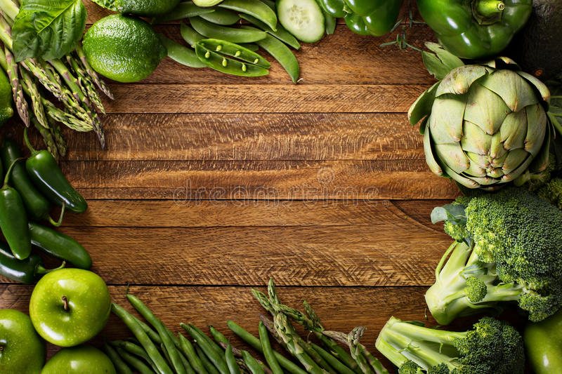 Variety of green vegetables and fruits stock image