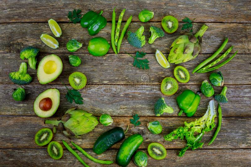 Variety of green vegetables on the table broccoli and avocado stock photos