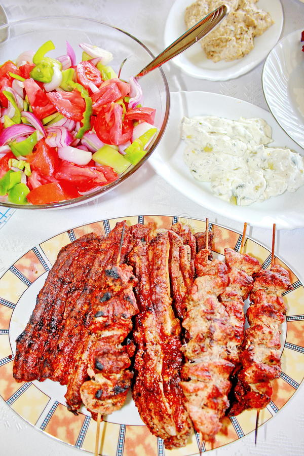 Variety grilled meat and salads