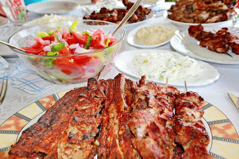Variety grilled meat and salads stock photos