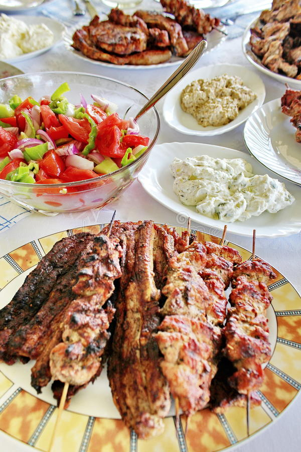 Variety grilled meat and salads royalty free stock photo
