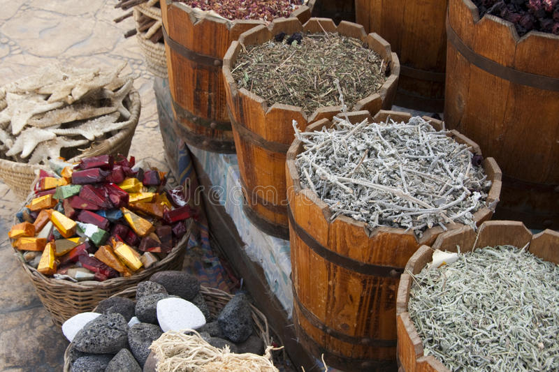 Variety of Herbs and spices in buckets. Tea, Herbs, Spices, Incense, Sea Stars, Pumice Stone in Buckets on a market in Egypt royalty free stock photography