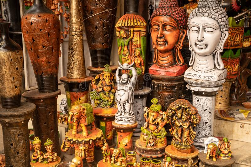 Variety of hindu and buddhism buddha statues and gods for sale at a market in New Delhi India.  royalty free stock images