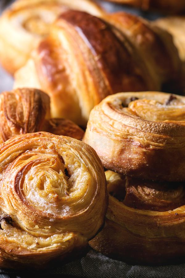 Puff pastry buns. Variety of homemade puff pastry buns cinnamon rolls and croissant. Close up royalty free stock photos