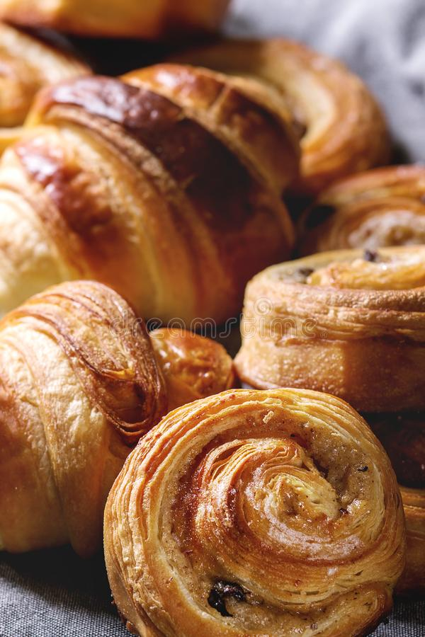 Puff pastry buns. Variety of homemade puff pastry buns cinnamon rolls and croissant. Close up stock image