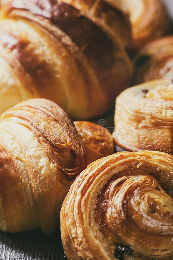 Puff pastry buns. Variety of homemade puff pastry buns cinnamon rolls and croissant. Close up royalty free stock images