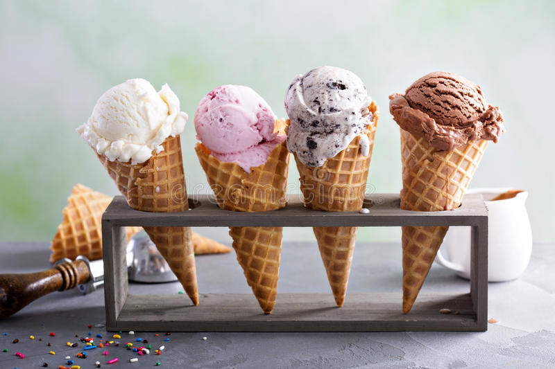 Variety of ice cream cones. Variety of ice cream scoops in cones with chocolate, vanilla and strawberry royalty free stock photography
