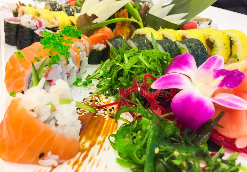 Variety of japanese sushi rolls on a white plate royalty free stock photo