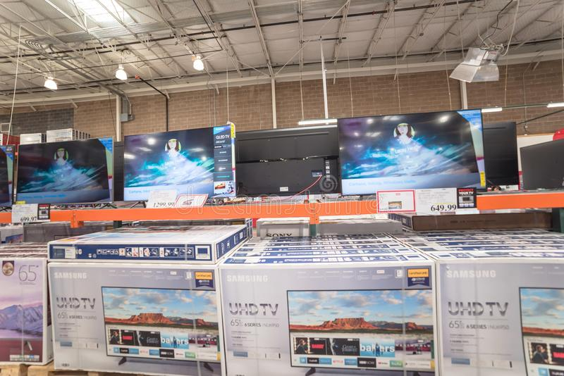 Variety of 4K, UHD, LED, LCD TV on display at Costco wholesale warehouse store royalty free stock photos