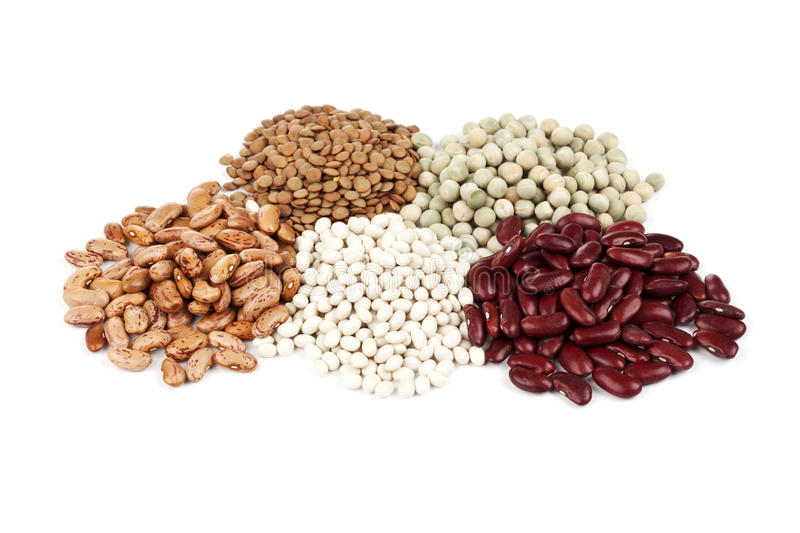Variety of legumes. Various legumes - beans, lentils and peas - on white background stock image