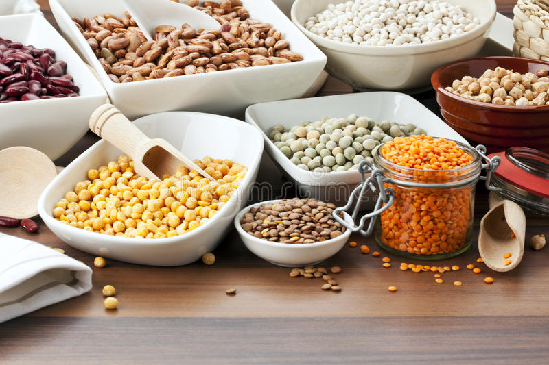 Variety of legumes. In bowls on table royalty free stock images