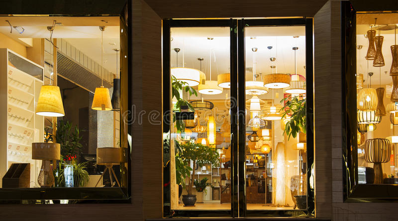 A variety of lightings In a lighting shop,Commercial lighting, Home Furnishing lighting. A variety of styles of Modern lighting Through the show window of a stock photos