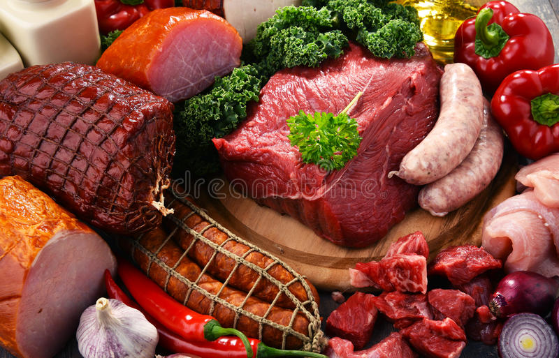 Variety of meat products including ham and sausages.  royalty free stock photos