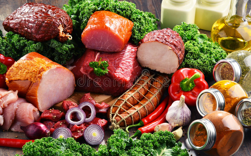 Variety of meat products including ham and sausages.  stock image
