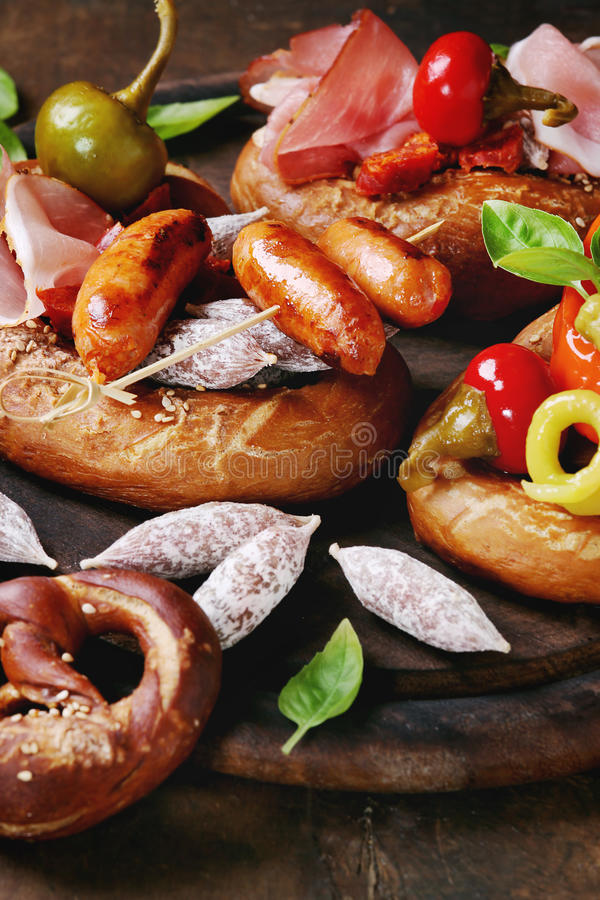 Variety of meat snacks in pretzels royalty free stock photography