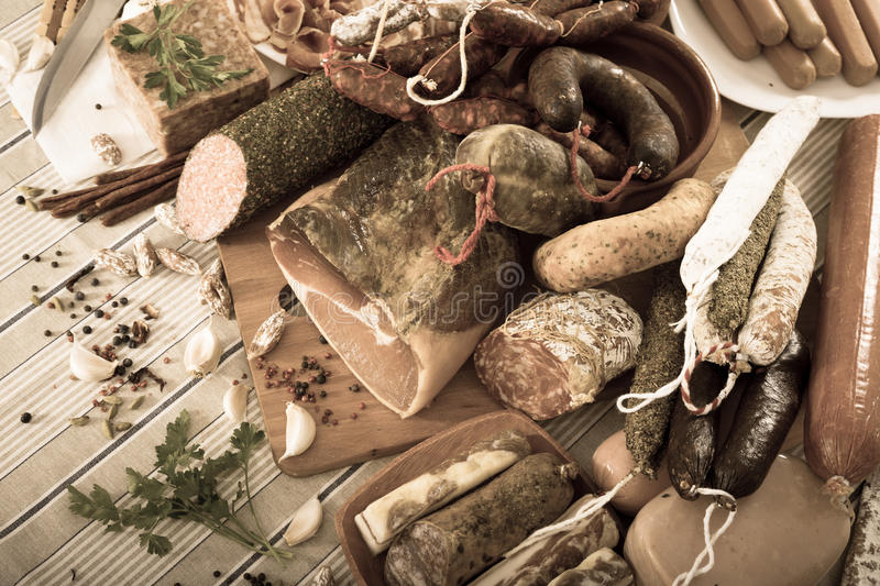 Variety of meats and sausages on table. Variety of meats, sausages and mince on table stock photography