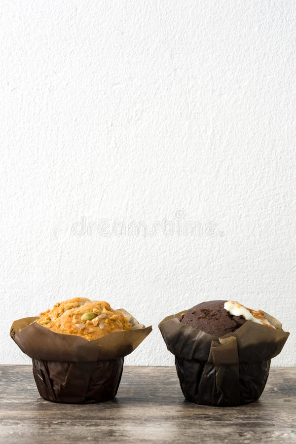 Variety of muffins on a wooden table royalty free stock photography