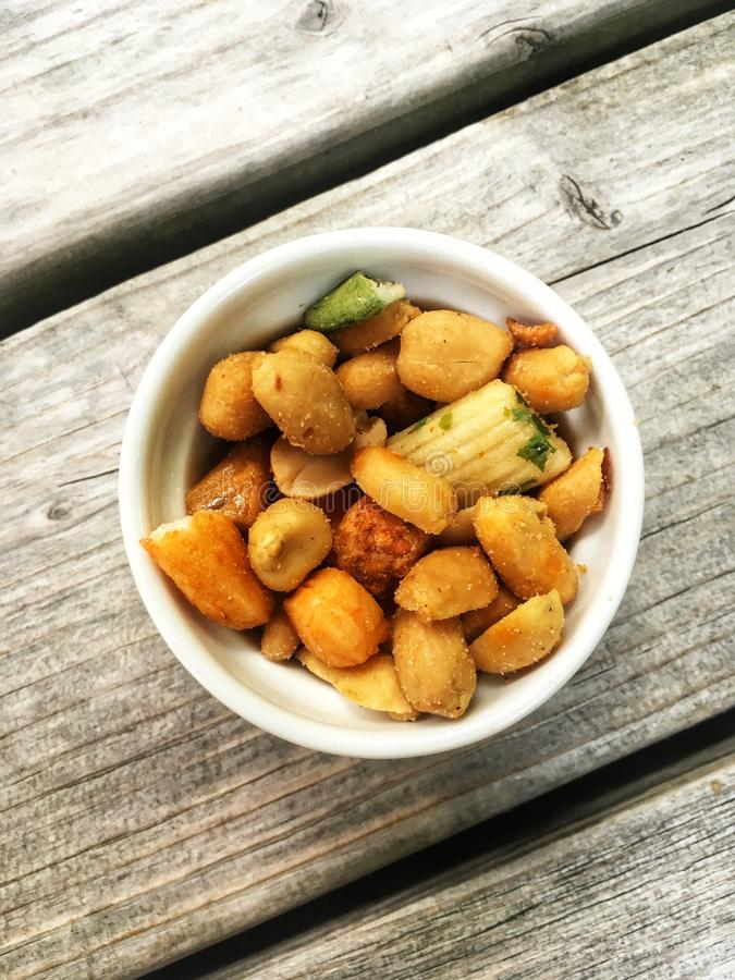 Variety of nuts in a bowl - top view stock photo