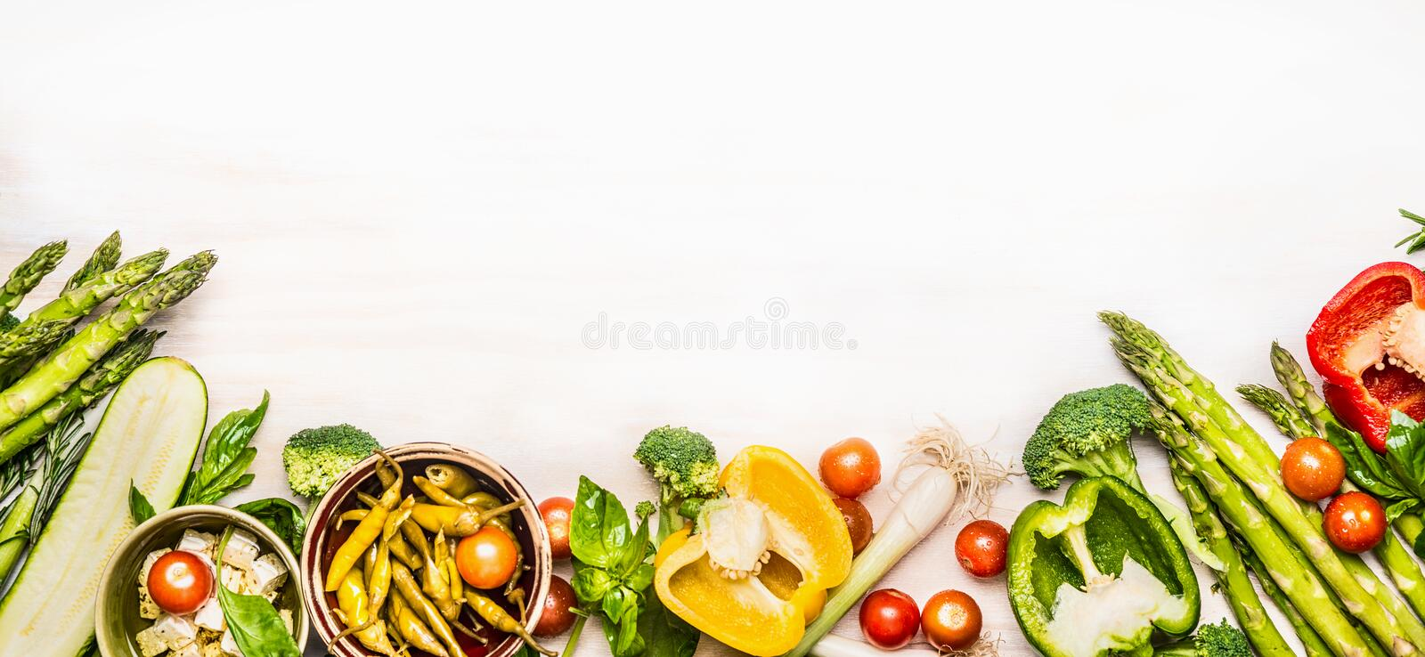 Variety of organic vegetables ingredients with asparagus and feta for delicious seasonal cooking , white wooden background, top vi royalty free stock image