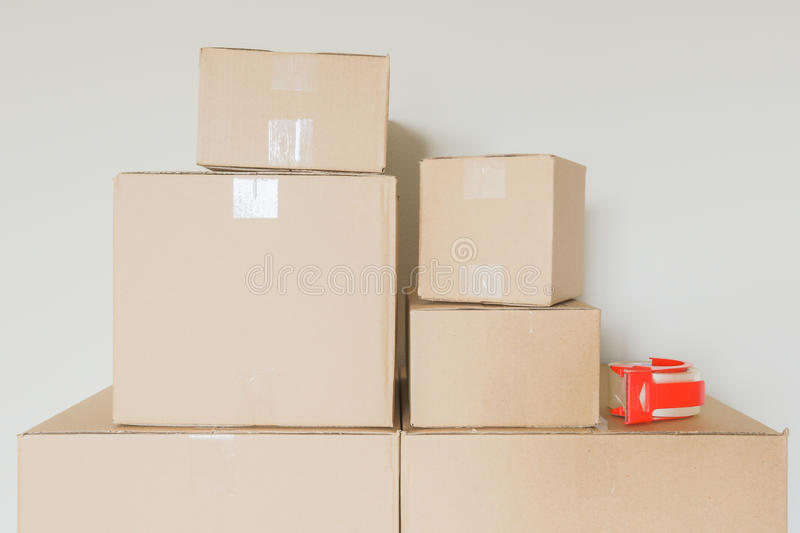 Variety of Packed Moving Boxes In Empty Room stock image