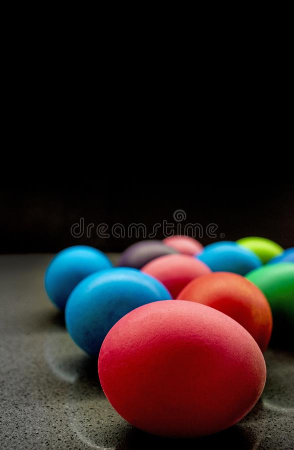 Variety of painted Easter eggs on black background stock image