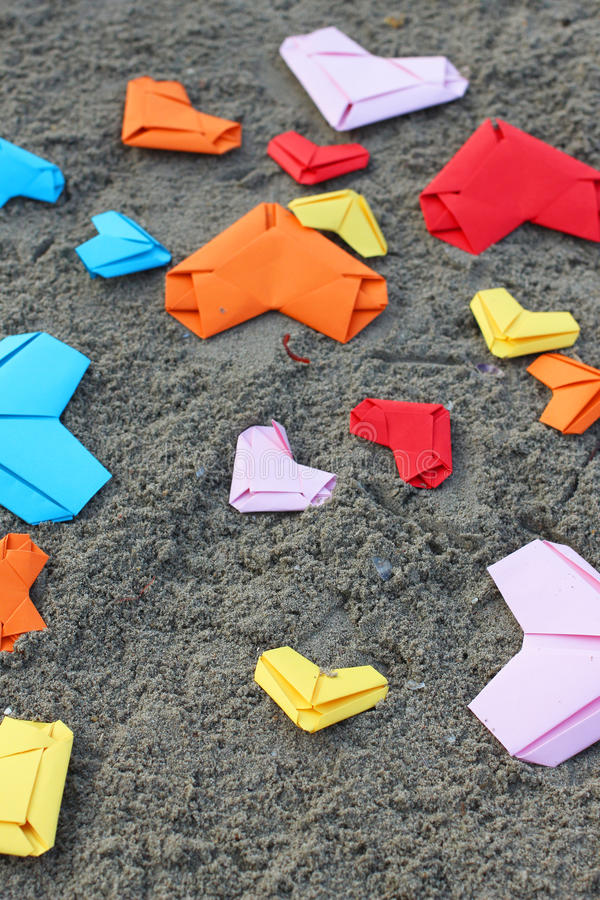 Variety paper hearts. On beach background stock photography