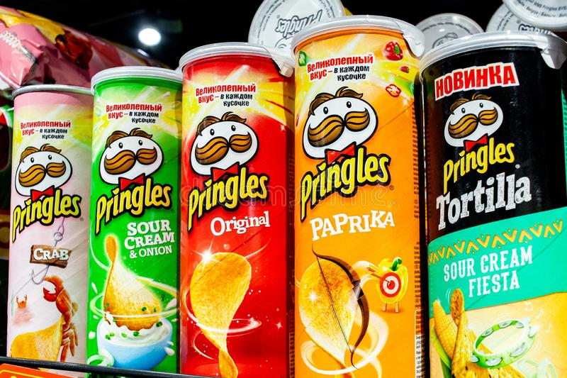 Minsk, Belarus, March 13, 2019: Variety of Pringles Potato Chips display in the supermarket shelve. Pringles chips are made by Pro royalty free stock photos