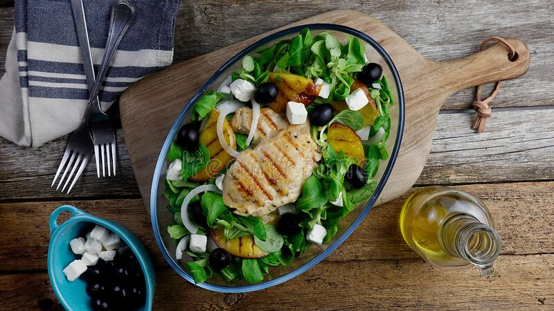 healthy salad with grilled chicken and nectarines stock photos